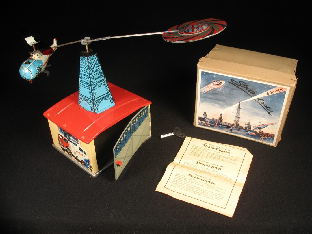 Vintage Antique Tin LithographSpace Strato Helicopter with Flying Saucer UFO Space Ship Wind-up Toy Huki West Germany