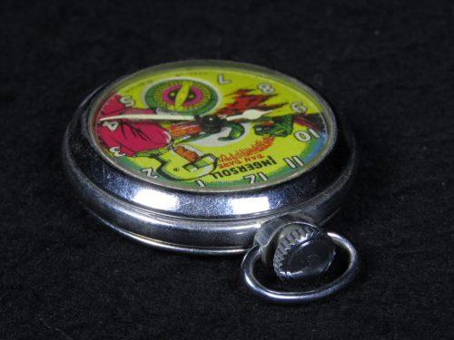 Antique Metal Pocket Watch of Dan Dare with Dinosaur