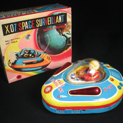 Antique Vintage X-07 Space Surveillant - Masudaya – Japan Tin Lithograph Battery Operated Futuristic Flying UFO Saucer with Astronaut Toy For Sale
