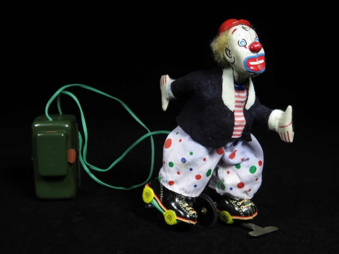 Vintage Antique Tin Lithograph Battery Operated Circus Toy White Face Roller Skating Clown TPS Japan