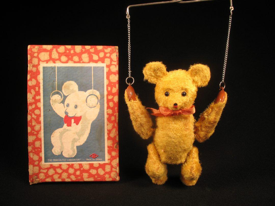 Modern toys swinging bear